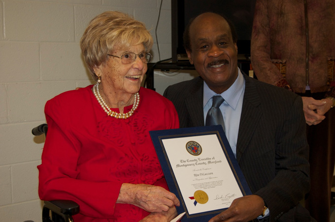 Rita DiLazzara receives certificate from County Executive Isiah Leggett